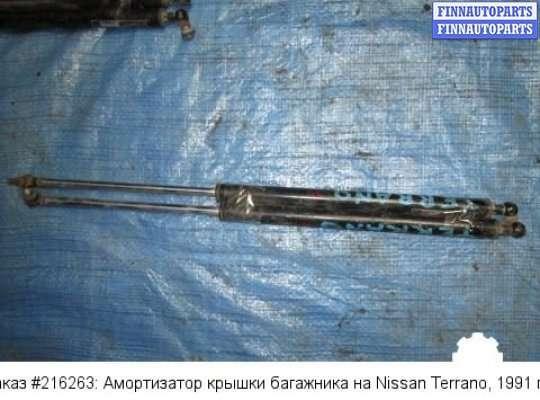 Амортизатор крышки багажника на Nissan Terrano I WD21